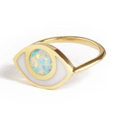 Eye ring Inlaid with porcelain and opal. Made to protect you, inspire you andempower you.  Good vibes only. All inlay is done by hand in NYC, and due to the nature of the stones colors might vary slightly.18K Gold on Brass.
