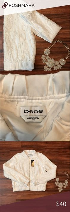 BeBe white lace zipper jacket Super cute white lace zipper jacket. Looks awesome with jeans or layered over a dress. Never worn. Purchased as an impulse buy. bebe Jackets & Coats
