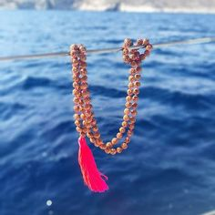 Kalimera ☀️☀️☀️from the Aegean sea with #lindahering necklace Arjuna Rudraksha pink #madewithloveinbaliღ  #bali #necklace #accessories #arjuna #jewellery #lookoftheday #coloursofbali #handmade #jewellerygram #handmadejewellery #rudraksha #fashionista #giftforher #musthave #hippiechic #fashionista  #bohostyle #bohemianstyle #boholuxe #rudraksha #artisinal #yogajewellery #meditation #zen #yoga #bohemianstyle #lindaheringnecklace #ellada #lovegreece #griechenland Zen Yoga, Meditation, Hippie Chic, Bohemian Style, Bath Salts, Beach Towel, Boho Fashion, Bali, Handmade Jewelry