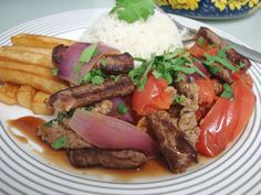 Lomo saltado, Chinese inspired feast for the senses-Peru    SCRUMPTIOUS STIR FRIED SIRLOIN STEAK AND VEGGIES WITH FRENCH FRIES AND RICE.