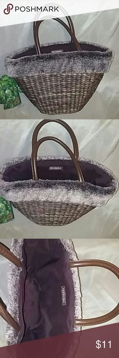 Bath & Body Works basket tote This is pre-loved but in excellent condition and absolutely adorable with its fur trim. Of course it's faux fur and extremely soft. Outside basket is in excellent shape and sturdy. Inside is clean and taken care of. No pockets anywhere inside or out 15x13x5 Bath & Body Works Bags Hobos