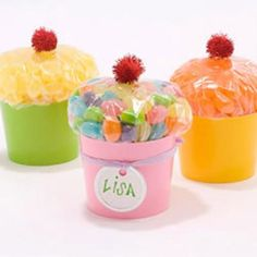 """""""Cupcakes!""""  Cute idea for goody treat or small gift.  Made from paper cup, red pom-pom, and candy filled sandwich baggie."""