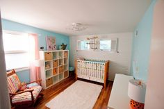 Love the orange and blue! - Everly's Nursery, via Flickr.