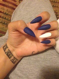 Navy blue and white stiletto matte nails