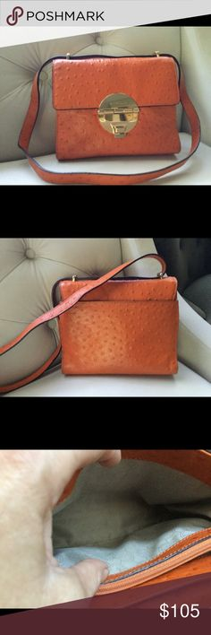 Michael Michael Kors ostrich Embossed leather  bag Tangerine Margo ostrich embossed leather Shoulder bag. Beautiful gold hardware. Back wall side pocket snap closure gently used.Tan MK lining in perfect condition, no stains. There is one very-small pin si