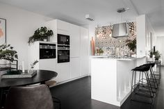 White kitchen with tiled wall
