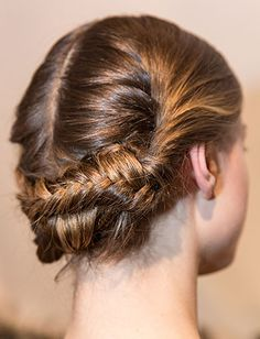 Braided updo - two fishtail braids crisscrossed & pinned at back of head.  Christian Siriano - NYFW Fall 2013