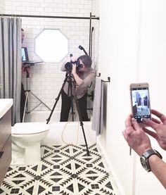 Gloomy day made much brighter by the company of amazing women (and some very cool dudes). The fabulous @juliesoefer and @annamolvik shooting @carmelolita's snazzy bathroom for @betterhomesandgardens kitchen and bath magazine. Harry is hiding in the tub with a computer. . . . . . . #theshowmustgoon #erinwilliamsondesign #blackandwhitebathroom #cementtile #getpublished #gettheshot #instagood #leanin #silverlining #beautifulpeople #meta