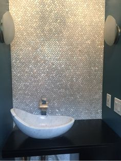White Herringbone mother of pearl tile used in powder room,easy to be cut and pasted onto wall