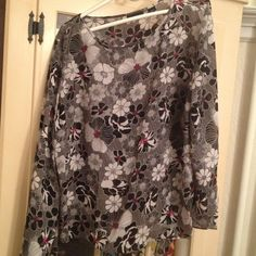 Red, white and black flower sheer top. This is a beautiful black red and white floral sheer top. It has 3/4 sleeves and a tie on the left side see pic 3. It was worn once and is in amazing condition! Apostrophe Tops