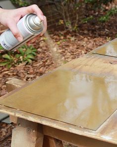 gold spray paint backs of mirror