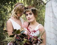 Boho brides in Minna eco friendly wedding dress flower crown feather crown and wild florals for a woodland wedding