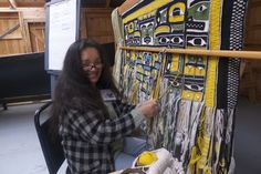 Clarissa Rizzal is a Raven. She's from the T'akdeintaan clan (Tlingit). Clarissa Rizal holds true to her clan identity as a full-time, multi-faceted artist since 1980 working in fiber, painting, music, print-making, landscaping and sculpture.