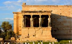 Next to the Parthenon is the Erechtheion with the Caryatids, the famous statues of six young women holding up its porch.