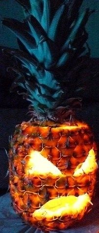 Make a jack-o'-lantern out of a pineapple.