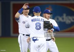 Justin Smoak of the Toronto Blue Jays celebrates their victory with Kendrys Morales and Josh Donaldson during MLB game action against the Cincinnati Reds at Rogers Centre on May 2017 in Toronto, Canada. Justin Smoak, Rogers Centre, Mlb Games, Josh Donaldson, American League, Toronto Blue Jays, Toronto Canada, Cincinnati Reds, Victorious