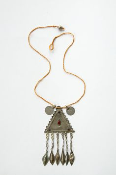 Turkmen Kuchi Dangle Necklace- This is a beautiful vintage Kuchi necklace. This necklace has a turkmen kuchi triangle pendant with a red stone