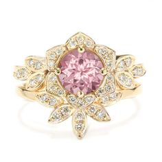 Lily flower Tourmaline and diamonds engagement ring with a matching leaves gold diamond wedding ring. Center stone is purple pink Tourmaline . Beautiful vintage style. ♥ Center stone: 0.7ct - 6-mm -purple pink Tourmaline  ♥ Side diamonds : 0.2ct , G, VS-SI  ♥ Side band set with : 0.075ct , G, VS-SI  ♥ The ring is made from 14K or 18K , white, yellow or rose.  ♥ Each ring is custom made for your size, your wanted gold color, and purity. ♥ You have a short video link here >>> https:&#...