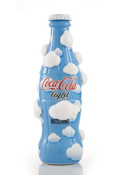 Coca-Cola Light by Moschino Coca-Cola bottle a makeover - its contribution to the Tribute To Fashion charity project for the Abruzzo Region, organised by Coca-Cola Italia in conjunction with the Municipality of Milan. Coca Light, Cool Packaging, Bottle Packaging, Packaging Design, Fashion Packaging, Moschino, Always Coca Cola, Coca Cola Bottles, Sodas