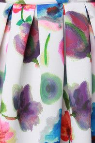 Spice up Sunday brunch with a bit of floral fun from the Posie On Over Ivory Floral Print Midi Skirt! Padded ivory neoprene gives this pretty midi plenty of structure and volume from a high banded waist that tops box pleats and hidden side seam pockets. Bold watercolor flowers dance throughout in vivid hues of green, blue, fuchsia, purple and yellow. Exposed back hot pink zipper. Unlined. 100% Polyester. Dry Clean Only.