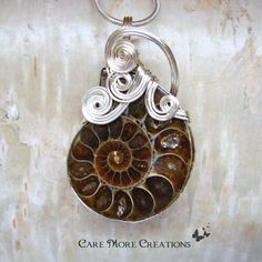 Ammonite Fossil Wire Wrapped Pendant Necklace in Silver by CareMoreCreations, $69.00