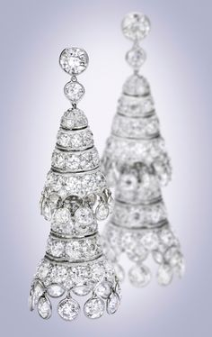 Pair of Platinum and Diamond Earrings. The tapered cone-shaped links supporting fringes, topped by two old European-cut diamonds weighing approximately 1.10 carats, further set with smaller old European-cut diamonds weighing approximately 26.90 carats.
