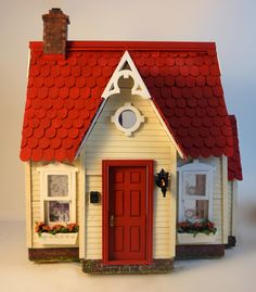 I am going to make some orange curtains and redo the rug so there is some orange inside the house. Putz Houses, Fairy Houses, Doll Houses, Miniature Houses, Miniature Dolls, Dollhouse Dolls, Dollhouse Miniatures, Victorian Dollhouse, Modern Dollhouse