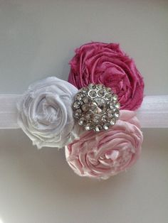Baby Headbands - Easter Headband - Spring Headband - Pink and White Fabric Flower Headband with Rhinestone Button - Rolled Rosettes. $14.00, via Etsy.