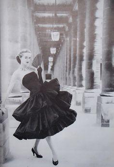 Christian Dior dress, 1955; photographed under  the colonnades on rue de Rivoli, Paris (I believe...).