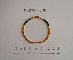 """This bracelet uses international Morse code to spell out the name """"Patroclus"""". Each round gold/silver-coloured bead represents a dot, each long gold/silver-coloured bead represents a dash, and each coloured bead signifies the space in between each letter. A fun and subtle way to keep your favourite mythological figure close to you!"""