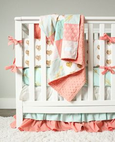 Coral, mint and gold crib bedding