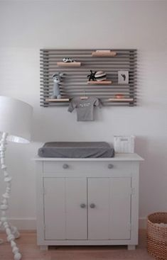 A section of Ikea's Mandal Headboard, mounted above the changing table, provides…