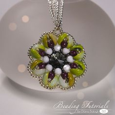 Piggy's flower pendant tutorial by baloghdia. This particular teacher is SUPER neat and offers both illustrations (beading diagrams) AND photos of the beading work. An excellent way to start beading, if you are just starting.