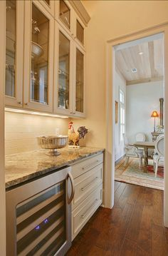 Butler's Pantry Ideas. Formal Dining with Butler's Pantry that connects this space to the Kitchen beyond. #ButlersPantry  Highland Homes, Inc.