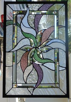 Beautiful Abstract Stained Glass Window Hanging ... measures 26 X 17 3/8...POLISHED BRASS FRAME(edging)...Hangs either way....like this design but wrong colors or dimensions?.......custom orders are what I do....visit: stevesartglass