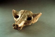 #3 Camelid sacrum in the shape of a canine. Tequixquiac, central Mexico. 14,000-7000 BCE. Bone.
