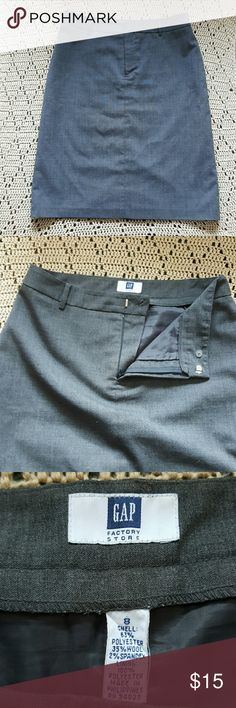 Gray Gap women's skirt Gray skirt with slit in back.  Can be worn high waisted or at hips depending on your build. GAP Skirts Midi