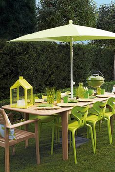 Citrus Summer. Zesty lime chairs and accessories add punch to a natural wood table; this alfresco dining area is bound to get everyone in the summer spirit.