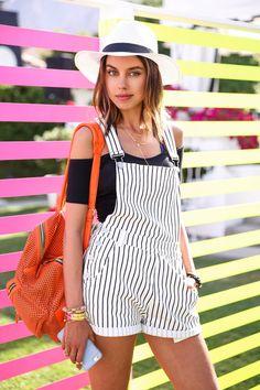 orange backpack with striped shortalls and off shoulder top