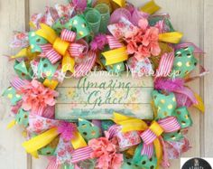 This is a flirty, romantic spring or summer wreath made with denim and pink Burlap mesh. Its full of ribbons, bows, tulips and peonies! This