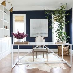 @studiomcgee created a stunning contrast in this #office with #walls in Deep Royal 2061-10 accompanied by Simply White OC-117 on the trim and built-ins.