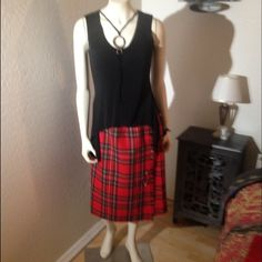 """Kilt-Style Skirt from Scotland Gorgeous kilt-style plaid skirt from Balmoral. (Pure wool. Dry clean only). Made in Scotland. Waist adjusts from 30""""-34"""". Pleated on sides & back. Has Velcro inside to help with adjustability & 2 buckles as well as a skirt pin on the outside. Waist to hem length is 26"""". Like new condition. No trades Balmoral Skirts"""