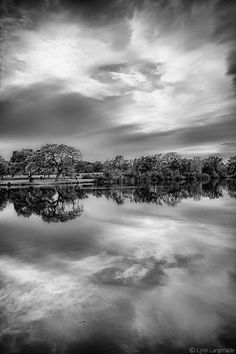 """""""Mirror"""" - Black and White Landscape Photography by Lynn Langmade - monochromatic photo of a lake reflecting dramatic clouds"""