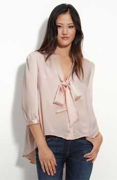 Remain Tie Neck Satin Blouse: A long tie at the V-neck and gathers at the shoulders lend feminine detail to a floaty, sumptuous satin blouse shaped by an exaggerated back hem. Nordstrom