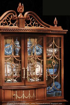 The Ferd Sobol Editions is currently in the process of building The Breakfront in miniature 1/12th scale. It is a stunning cabinet designed to showcase fine china, treasured mini collectibles or even an entire library. Have a sneak peek: TheSobolEditions.blogspot.com/2013/03/Breakfront-Ferd-Sobol-Editions25.html