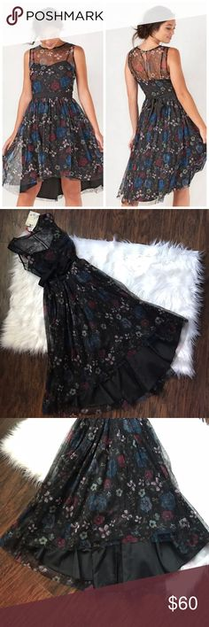 LC Disney Snow White Enchanted Black Floral Dress Such a beautiful dress! Limited Edition Snow White Collection from Lauren Conrad. Has a high low design and a sweetheart neckline. LC Lauren Conrad Dresses High Low