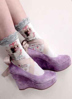 Angelot.... amazing victorian lacy socks. and I have shoes almost exactly like this, but theyre black leather and have a strap with a buckle, but same shape, height, and platform...so kinda not really. At all.