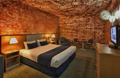 Caves You Can Actually Stay In Around the World -- DESERT CAVE HOTEL, AUSTRALIA -- While there are above ground options, you can opt out for the dug-out style living and find everythi. Underground Hotel, Underground World, Underground Living, Australia Hotels, South Australia, Cave Hotel, Red Centre, Unique Hotels, Travel