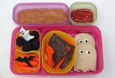 Homemade applesauce, blackberries, baby carrots, orange and black Halloween tortilla chips and salsa (chips from Target!), and blueberry jam sandwiches cut out like little ghosts. Jam Sandwiches, Halloween Snacks, Halloween Ideas, Homemade Applesauce, Whats For Lunch, Blueberry Jam, Chips And Salsa, Bento Box Lunch, Baby Carrots