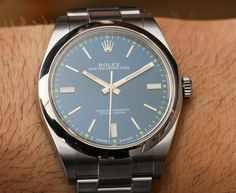 """ROLEX Oyster Perpetual Watches New For 2015 Hands-On - by James Stacey - check out the hands-on photos & our writeup: http://www.ablogtowatch.com/rolex-oyster-perpetual-watches-baselworld-2015/ """"If you can imagine Rolex as Ben and Jerry's, then the Oyster Perpetual is vanilla ice cream. It's the building block from which models like the Rolex Submariner and Rolex Daytona have evolved. For 2015, Rolex has created a new 39mm version of the Rolex Oyster Perpetual, offering a slightly larger…"""